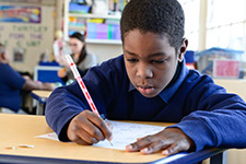 TTA male student working on reading